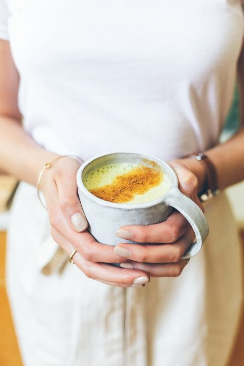 alison with turmeric latte