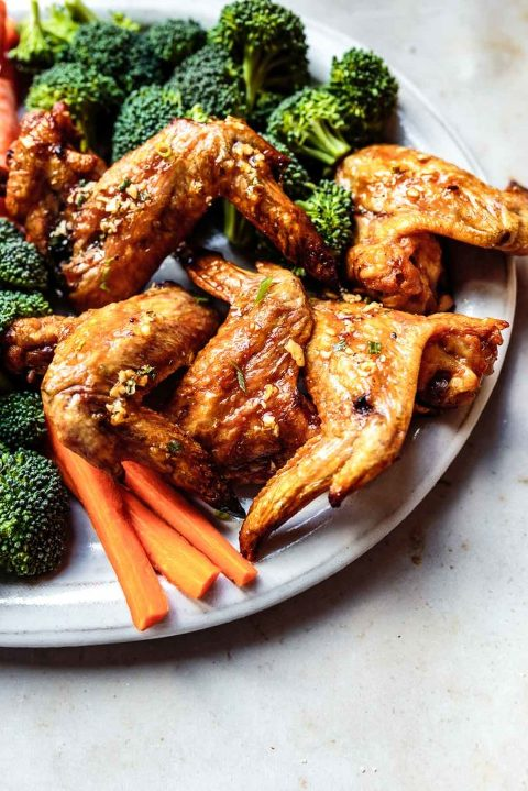 This crispy oven baked chicken wings recipe is the perfect crowd-pleasing appetizer or meal. Plus, because they're made without baking powder, they're AIP- and Paleo-friendly. Serve with some crudités to complete the meal!