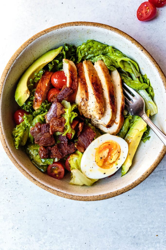 This Paleo Chicken Cobb Salad recipe is a classic summertime meal that turns simple chicken into a delicious, satisfying, and healthy meal.