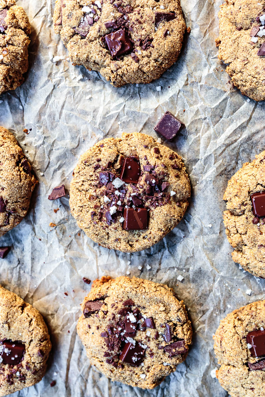 soft-baked chocolate chip cookies in a lined baking sheet