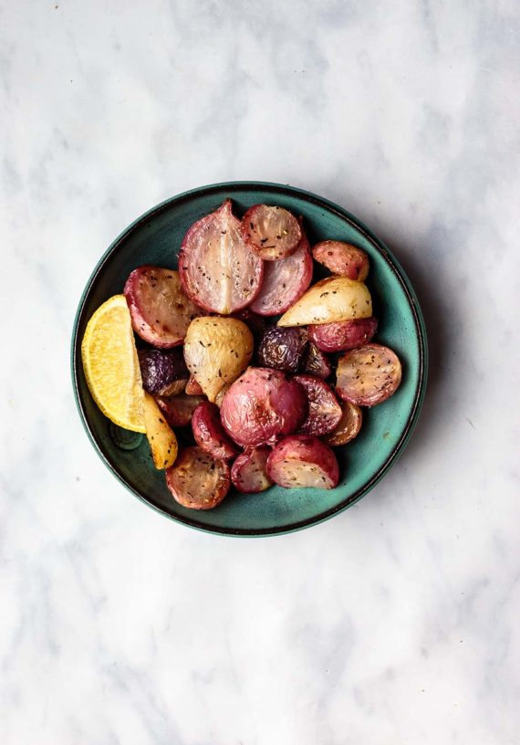 roasted radishes in a bowl with lemon